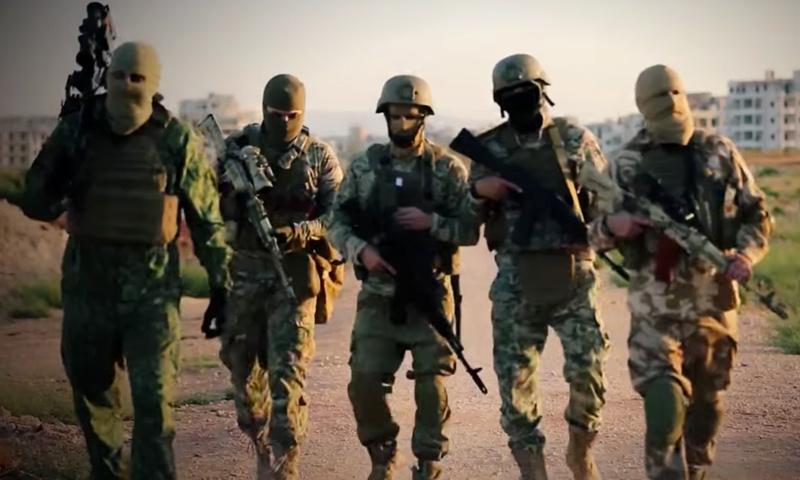 """مقاتلون في """"قوات النخبة"""" التابعة لهيئة """"تحرير الشام"""" (يوتيوب)"""