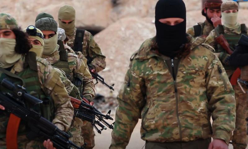 مقاتلون في هيئة تحرير الشام (وكالة إباء)