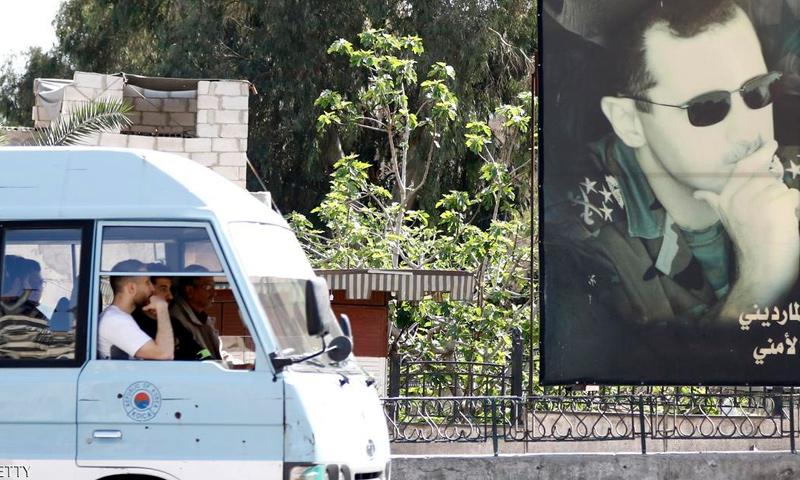 لافتة لصورة الرئيس بشار الأسد في العاصمة دمشق-(AFP)