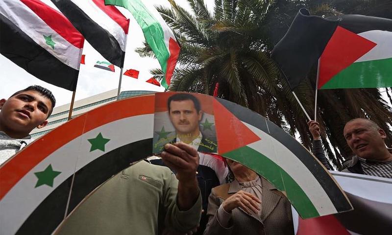 مسيرة مؤيدة لرئيس النظام السوري بشار الأسد- (AFP)