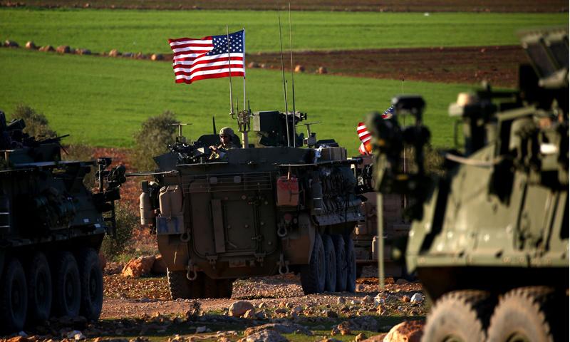 عربات عسكرية أمريكية قي مدينة منبج بريف حلب - (انترنت)