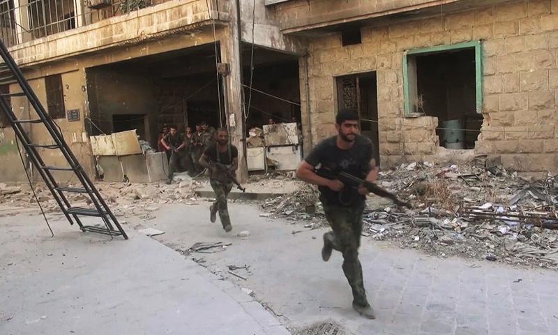 عناصر من قوات الأسد في محيط مدينة حلب- كانون الأول 2016 -(سبوتنيك)