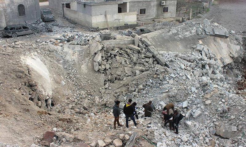 آثار قصف التحالف الدولي على بلدة الجينة - 18 آذار 2017 - (انترنت)