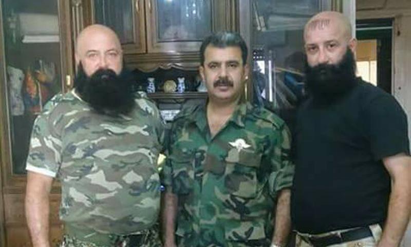 العميد في الحرس الجمهوري علي ديب (وسط)- (صفحات موالية)