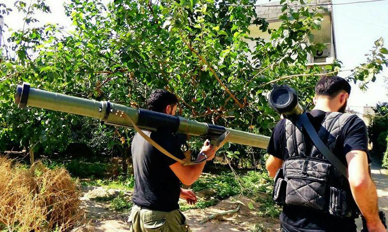 عنصران من المعارضة في منطقة بساتين برزة- الأحد 5 آذار (المكتب الإعلامي في برزة)