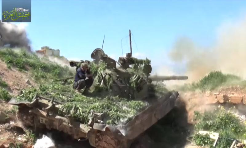 """دبابة تابعة لـ """"جيش العزة"""" في ريف حماة الشمالي الغربي- 28 آذار 2017 (يوتيوب)"""