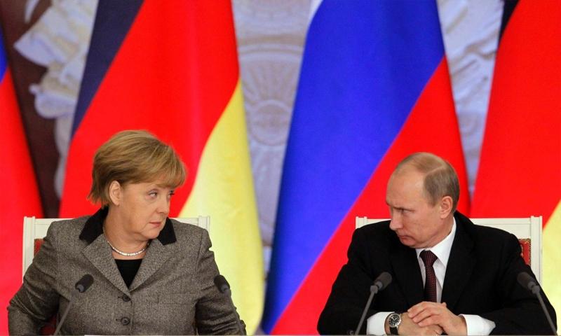 الرئيس الروسي فلاديمير بوتين والمستشارة الألمانية أنغيلا ميركل - (انترنت)