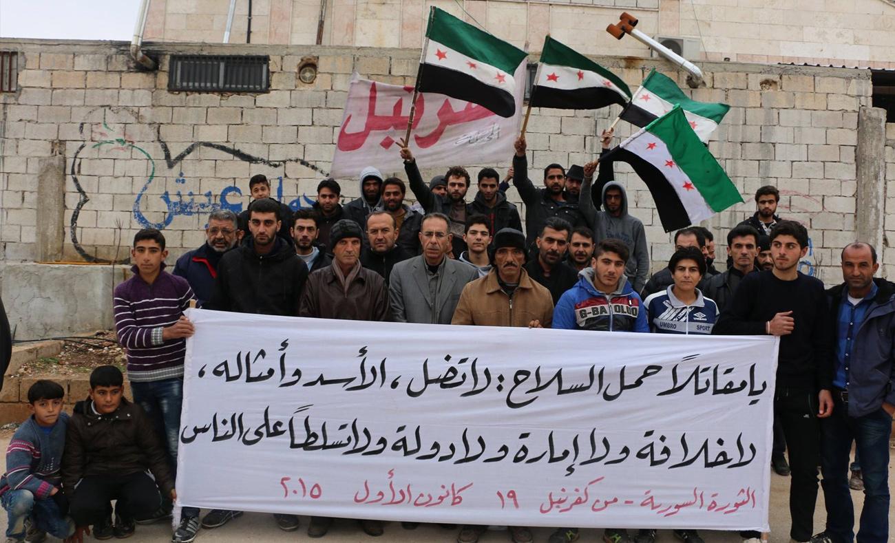لافتة حملها متظاهرون في كفرنبل - 19 كانون الأول 2015 (فيس بوك)