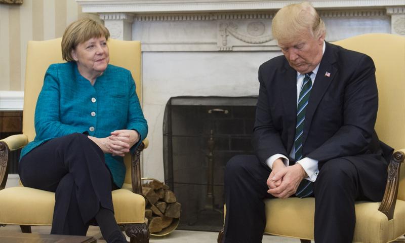 اجتماع الرئيس الأمريكي دونالد ترامب بالمستشارة الألمانية أنجيلا ميركل في واشنطن (IBtime)