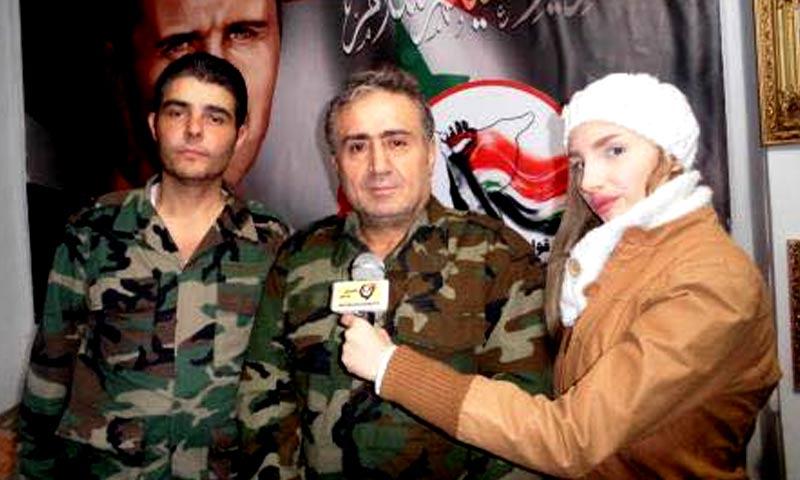 سامي أوبري، قائد الدفاع الوطني في حلب منتصف الصورة (فيس بوك)