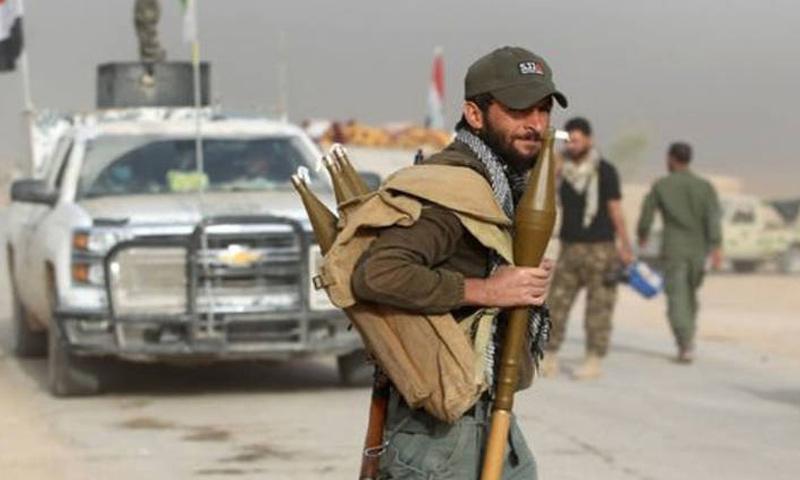 عنصر من الحشد الشعبي خلال المعارك ضد تنظيم الدولة - (انترنت)