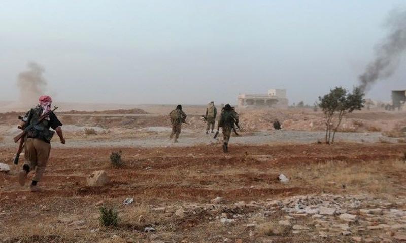 عناصر من تنظيم الدولة الإسلامية بريف حلب الجنوبي الشرقي - (انترنت)
