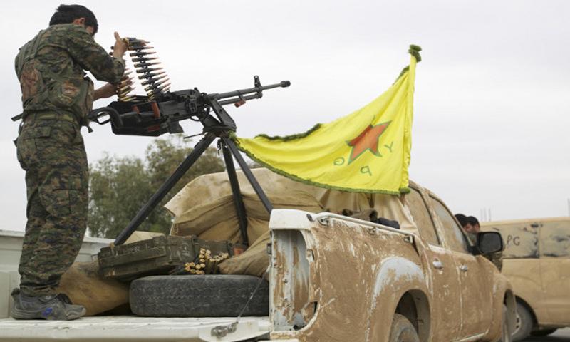 عنصر من وحدات حماية الشعب الكردية في مدينة عفرين - (انترنت)