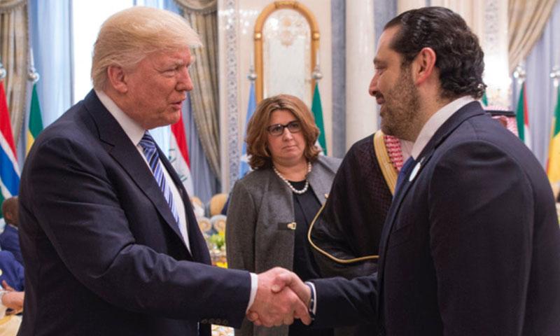 رئيس الوزراء اللبناني سعد الحريري يصافح الرئيس الأمريكي دونالد ترامب في القمة السعودية- الأمريكية (إنترنت)