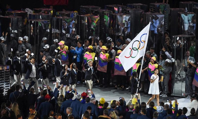 فريق الرياضيين اللاجئين أثتاء مشاركتهم في أولمبياد ريو دي جانيرو 2016 - (يونيسف)