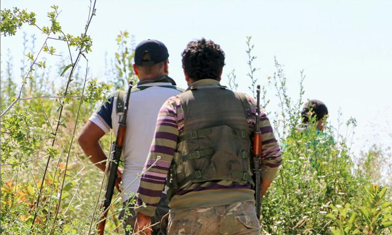 عناصر من حركة أحرار الشام الإسلامية على الجبهات العسكرية في ريف اللاذقية - (أحرار الشام)
