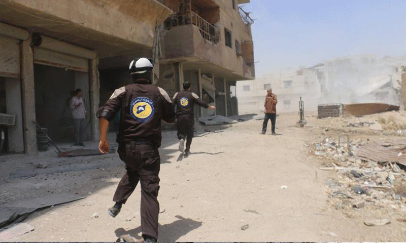عناصر الدفاع المدني يتوجهون إلى نقاط القصف في الغوطة الشرقية - 8 آب 2017 (الدفاع المدني في ريف دمشق )