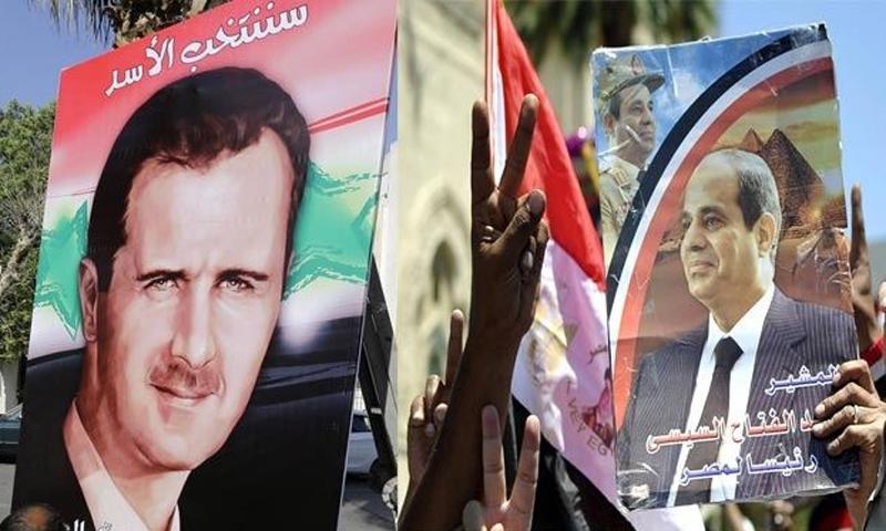 متظاهرون في شوارع القاهرة يرفعون صور السيسي والأسد (alwaght.com)