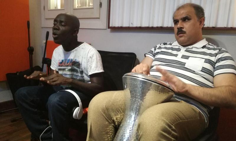 اللاجئ السوري أحمد والليبيري نثانايل (أنسا)