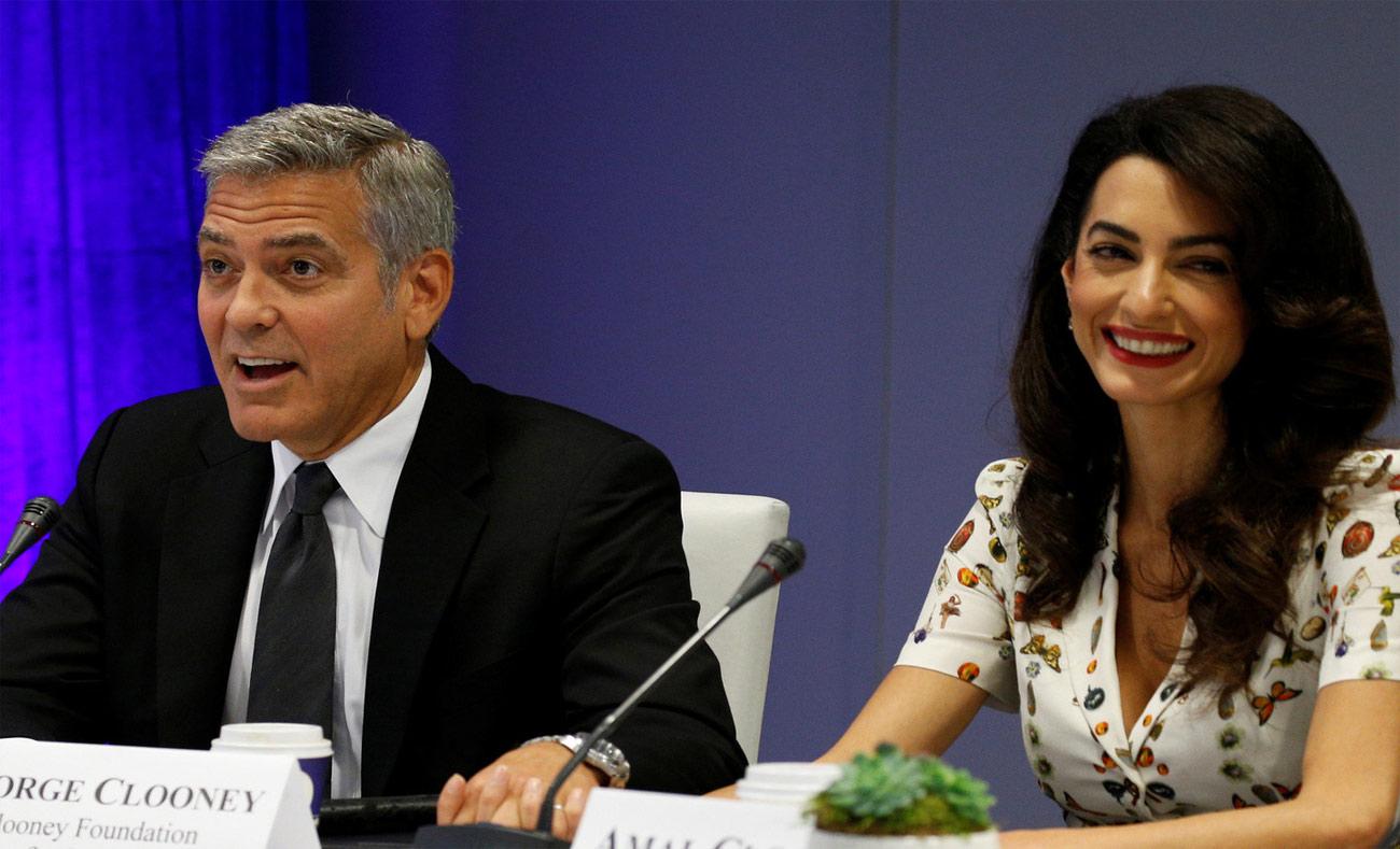 المخرج والممثل جورج كلوني وزوجته أمل علم الدين (AFP)