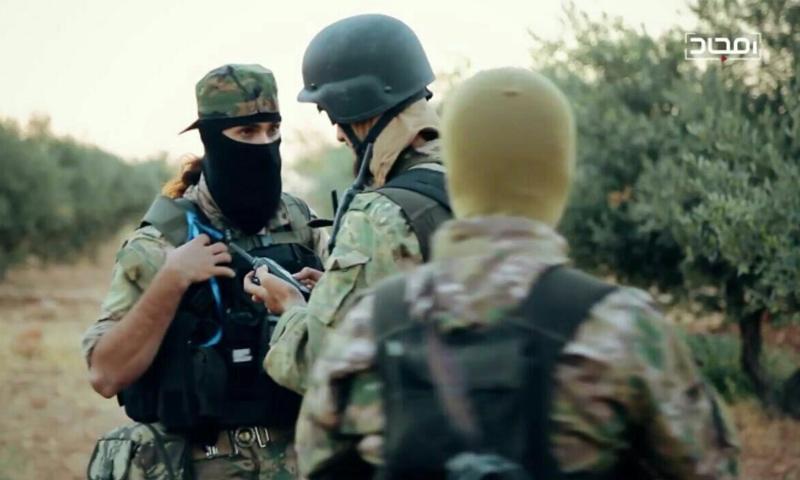 عناصر من هيئة تحرير الشام في ريف إدلب - (يوتيوب)