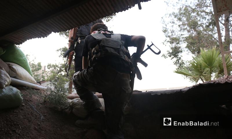 مقاتلوا المعارضة أثناء التقدم في إدارة المركبات- تموز 2016 (عنب بلدي)