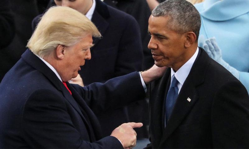 الرئيس الأمريكي السابق، باراك أوباما، والرئيس الأمريكي الحالي دونالد ترامب (AP)