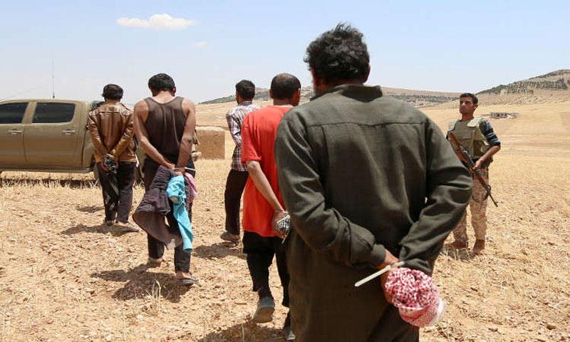 """معتقلين من قبل """"قسد""""في حلب بتاريخ آذار 2016(رويترز)"""