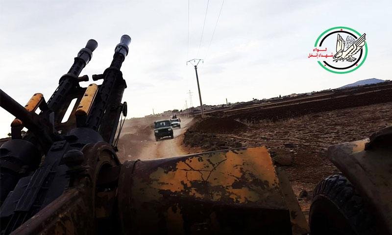 """تعبيرية: مقاتلو """"لواء شهداء إنخل"""" في درعا - 2015 (فيس بوك)"""