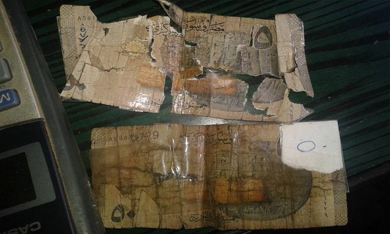 أوراق نقدية سورية تالفة (الإعلام الإلكتروني)