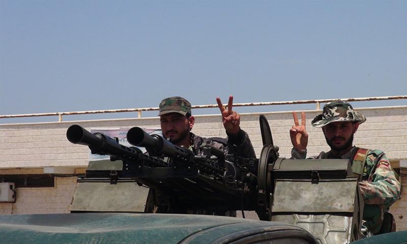 عناصر من ميليشيا الدفاع الوطني في محيط العاصمة دمشق - (سبوتنيك)
