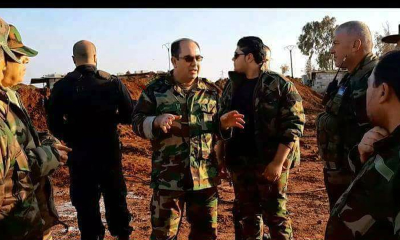 العميد في قوات الأسد وفيق ناصر مع عناصر له في السويداء - (فيس بوك)
