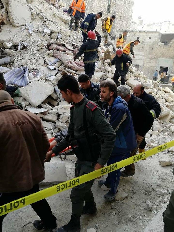 انهيار مبنى في حي ميسلون في حلب الشرقية- 5 آذار 2018 (وزارة الداخلية فيس بوك)