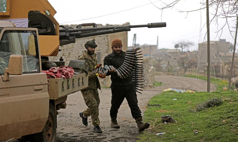 عناصر من الجيش الحر ضمن معارك مدينة عفرين - كانون الثاني 2018 (خليل الشاوي-رويترز)