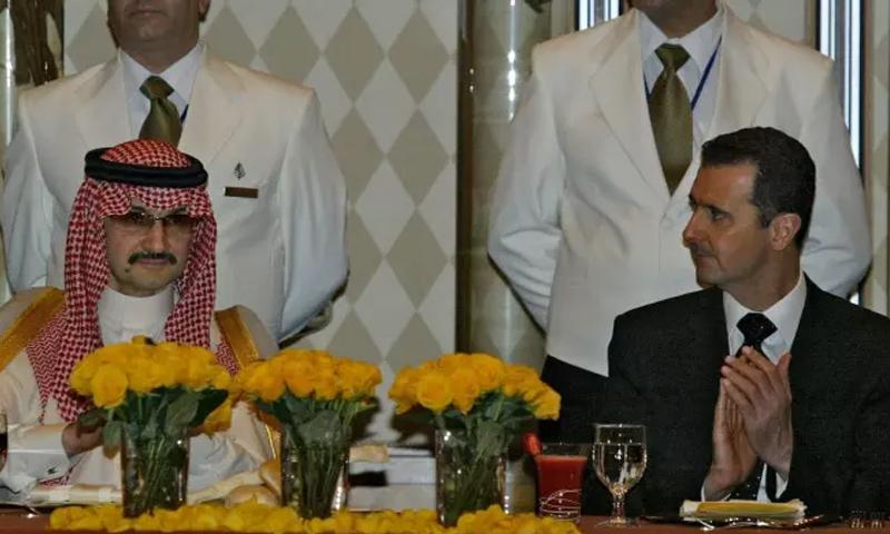 رئيس النظام السوري بشار الأسد والأمير الوليد بن طلال في حفل الافتتاح لفورسيزونز دمشق 2006 (AFP)