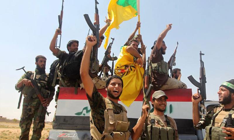 عناصر من الحشد الشعبي في معارك تنظيم الدولة على الحدود السورية العراقية -(رويترز)