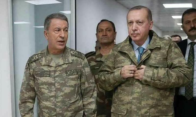 الرئيس التركي رجب طيب أردوغان ورئيس الاستخبارات العسكرية خلوصي آكار على الحدود التركية - كانون الثاني 2018 (الأناضول)