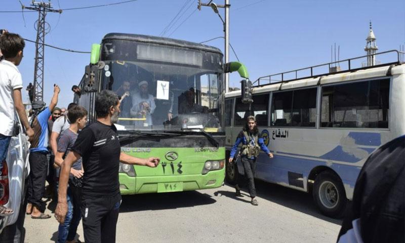 الباصات الخضراء تنقل أهالي حمص (يوتيوب)