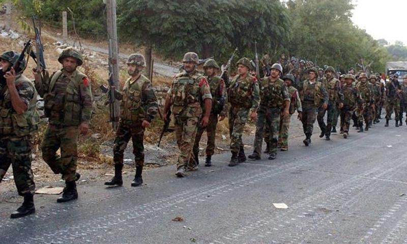 عناصر من قوات الأسد في ريف اللاذقية الشمالي - (فيس بوك)