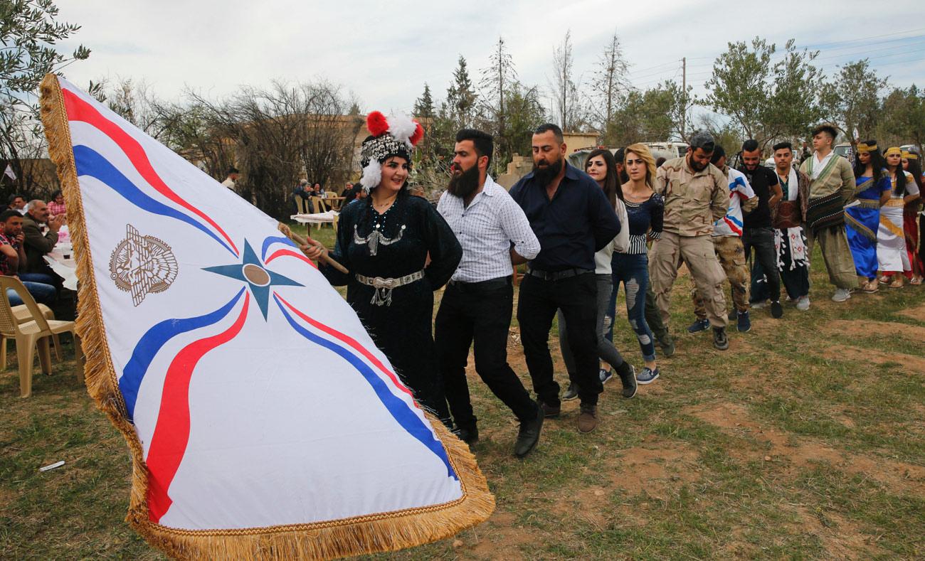 سريان يحتفلون بعيد الفصح في تل عربوش شمالي سوريا - 1 نيسان 2018 (AFP)