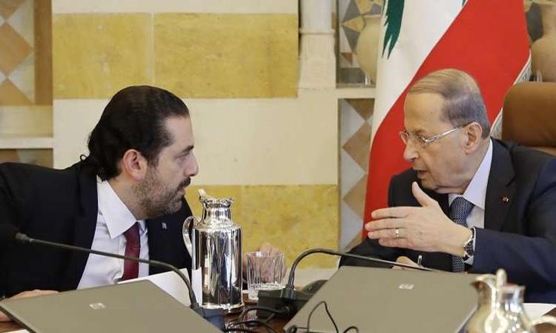 الرئيس اللبناني، ميشال عون، والسياسي سعد الحريري (AFP)