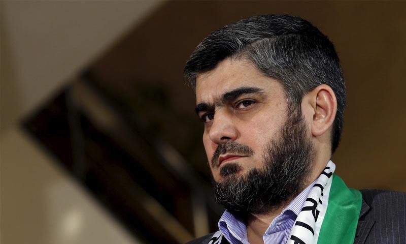 """محمد علوش رئيس المكتب السياسي في """"جيش الإسلام"""" من جنيف- 2016 (AFP)."""