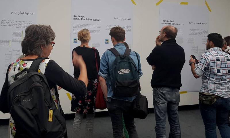 """معرض لصور """"قيصر"""" في مدينة شتوتغارت الألمانية 26 حزيران 2018 (عنب بلدي)"""