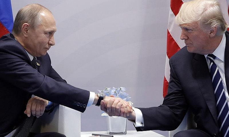 الرئيس الامريكي دونالد ترابم والرئيس الروسي فلاديمير بوتين (وكالة تاس)