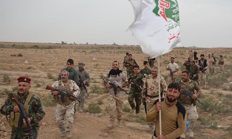 عناصر من الحشد الشعبي العراقي على الحدود السورية- العراقية- (انترنت)