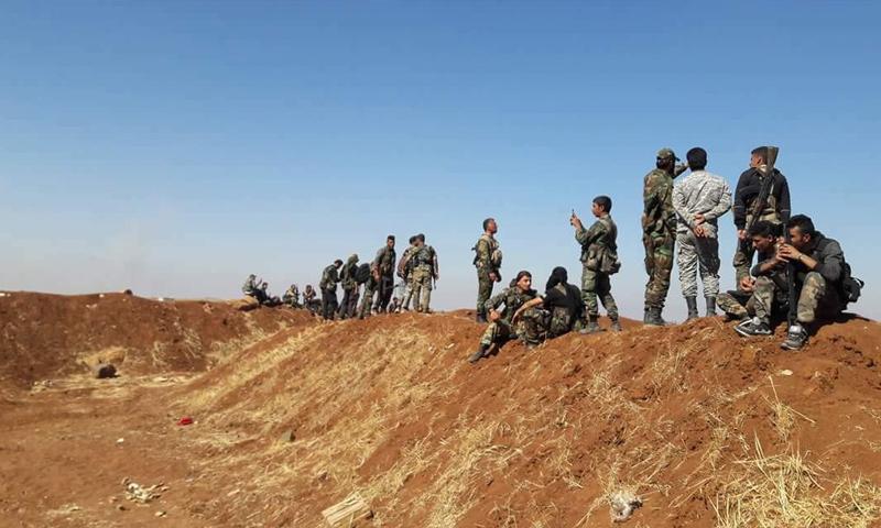 عناصر من قوات الأسد في محيط منطقة اللجاة بريف درعا الشرقي - 27 من حزيران 2018 (قوات النمر)