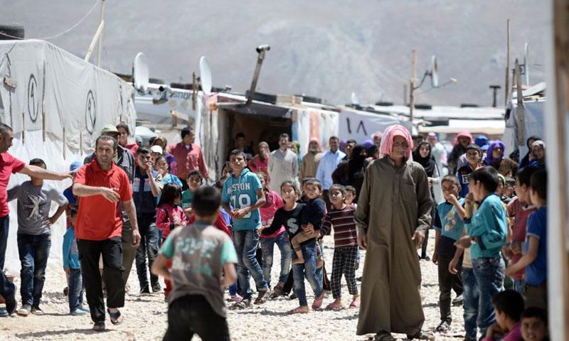لاجئون سوريون في مخيمات لبنان (AFP)