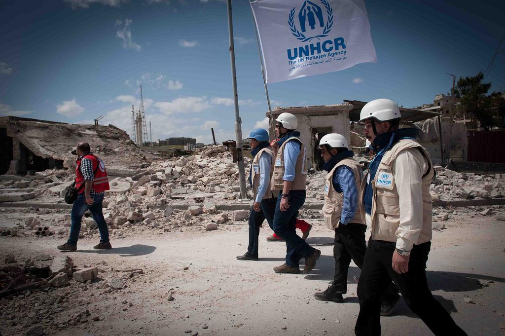 موظفون تابعون لمفوضية اللاجئين الأممية (UNHCR)