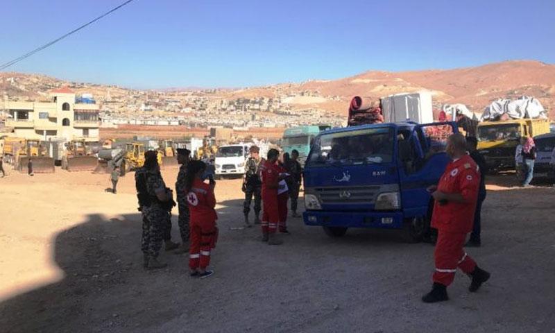 لاجئون سوريون يغادرون عرسال الى سوريا تموز 2018 (الوكالة اللبنانية)