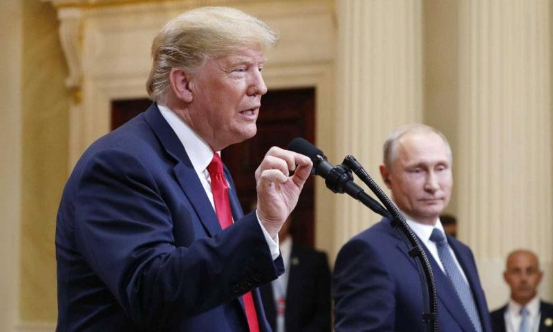 الرئيس الروسي، فلاديمير بوتين، مع نظيره الأمريكي، دونالد ترامب- تموز 2018 (وكالات عالمية)